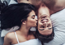 blissful guy kissed by wife on cheek
