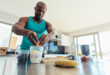 buff guy preparing post workout meal along with his Progentra pills