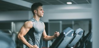 man focused on workout on treadmill