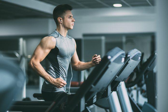man focused on workout on treadmill