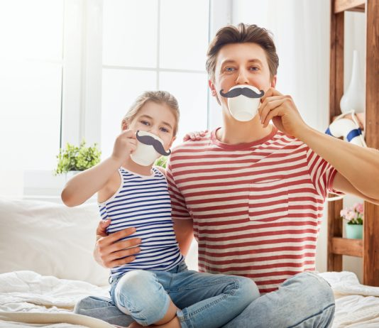 dad being silly with daughter, teacups with mustache