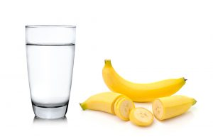 glass of water and banana