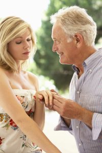 older man proposing to young woman has more vigor from Progentra use