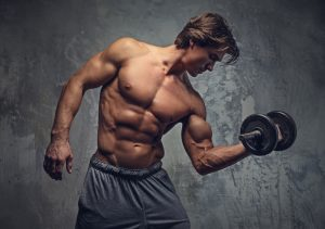 ripped guy dooing dumbbell bicep curls