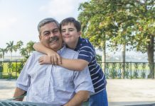 special needs boy hugs father