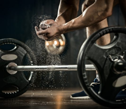 man ready to lift weights has more stamina with Progentra