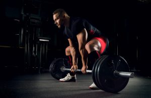 man doing heavy dead lift with good form