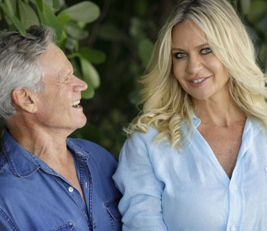 older man who takes Progentra pills admiring his younger wife