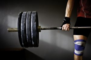 man lifting heavy weights has higher testosterone with Progentra