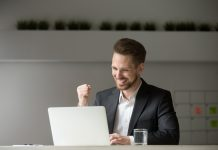 successful business man excited after reading about Progentra online