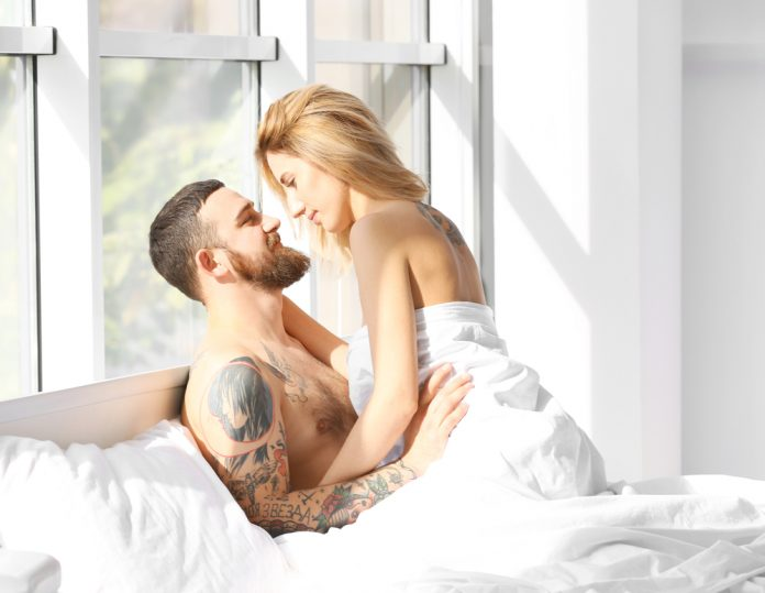 couple having morning sex in bed after man discovers Progentra